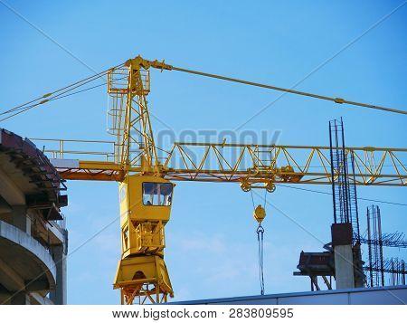 Crane. Construction Crane. Building Crane On The Background Of The Building. Tower Crane.