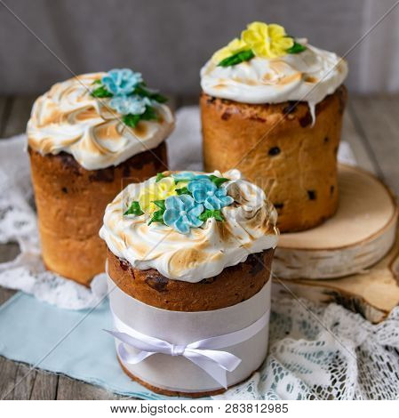 Three Traditionally Baked Orthodox Easter Cakes With Glace Icing And Bright Blue And Yellow Flowers
