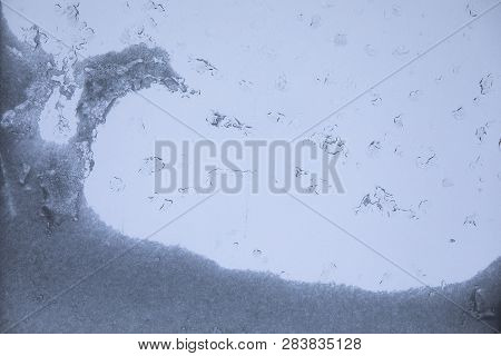 Melting Snow And Cold Water, Condensation On Window Glass, Transparent Glass In Winter And Ice With