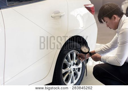 Asian Man Car Inspection Change Wheel Rubber Tires Car.close Up Hand Holding Car Screw Driver For Ca
