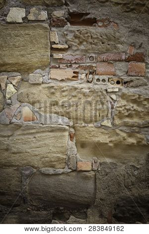 Old Broken Wall Made Of Mud Bricks, Textured Background Detail, Neglect And Ruin