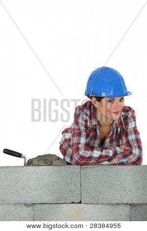 Gorgeous female bricklayer