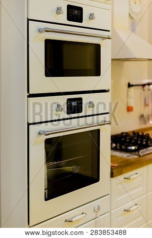 Elegant Kitchen Interior With White, Gray Furniture.modern Interior Of Kitchen With Electric Stove A