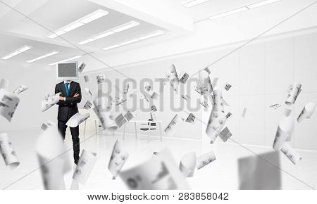 Businessman In Suit With Monitor Instead Of Head Keeping Arms Crossed While Standing Among Flying Pa