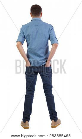Back view of a stylish man. Rear view people collection.  backside view of person.  Isolated over white background. A man in a shirt stuck his hands in the back pockets of jeans.