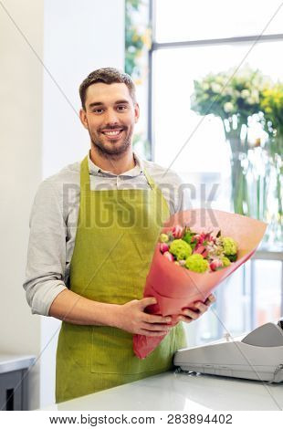small business, sale and floristry concept - happy smiling florist with bunch at flower shop
