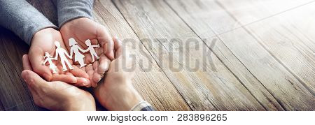Family Care - Hands With Paper Silhouette On Table