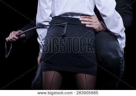 Man Hand Holding Whip On Woman Ass In Mini Skirt, Bdsm