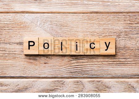Policy Word Written On Wood Block. Policy Text On Wooden Table For Your Desing, Concept