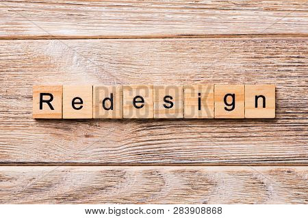 Redesign Word Written On Wood Block. Redesign Text On Wooden Table For Your Desing, Concept