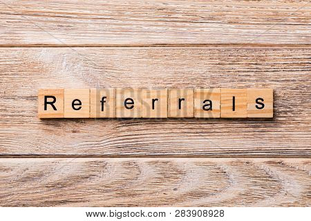 Referrals Word Written On Wood Block. Referrals Text On Wooden Table For Your Desing, Concept