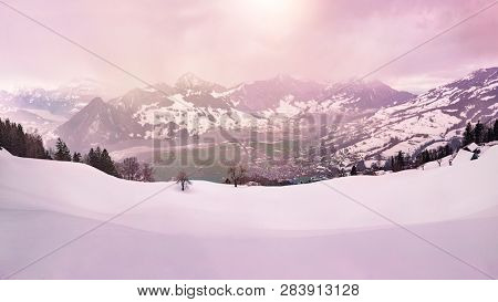 panoramic view over the swiss alps in winter during sunset