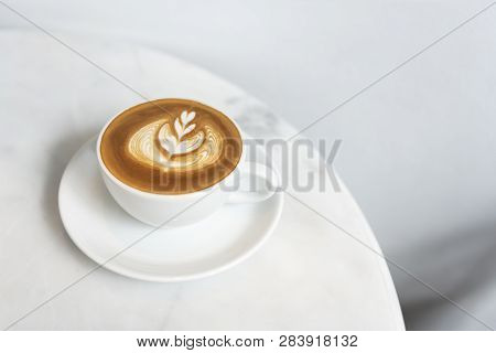 Latte Or Cappuccino With Frothy Foam, Coffee Cup Top View On Table In Cafe.
