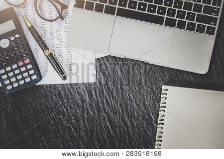 Financial Accounting Analysis Concept , Close Up Calculator And Accounting Laptop On Office Desk