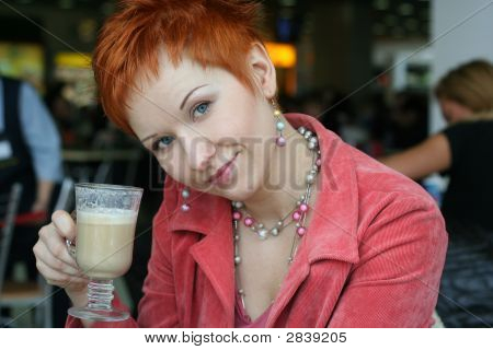Woman Dreanking Coffe In Cafe And Thoughtfully Looks Afar
