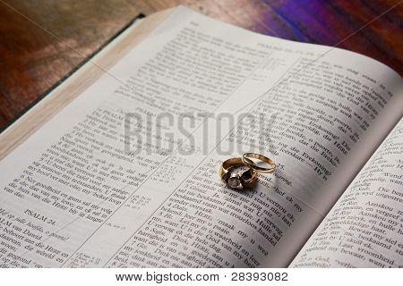 Wedding Rings Lying On Bible