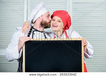 Couple With Blackboard For Advertisement. Lovely Family At Kitchen. Family Restaurant. Family Day. C