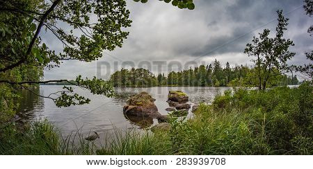 Autumn Rural River Shore Landscape. Rural River Panorama. Nature River Landscape. Dramatic Sky Over