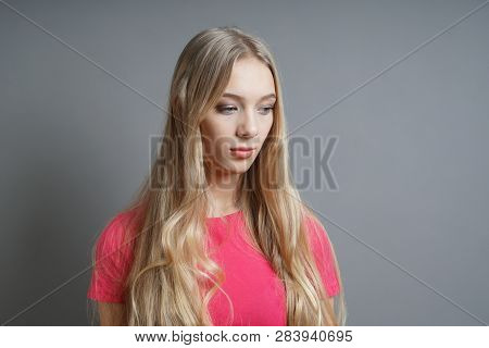 Melancholic Introverted Sad Girl Looking Down - Teenage Depression Concept - Gray Background With Co