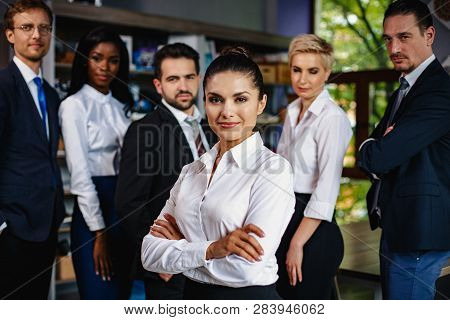 Team Of Motivated Young Business People. Business Woman Became A Leader In The Team. Close-up Shot