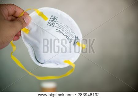 Close Up Of Protection Respirator For N95 Filter Face Mask In Hand