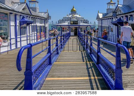 Eastbourne, Sussex, England, Uk - August 1, 2018: Blue Railings Leading You Into The Victorian Tea R