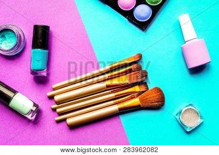 Set Of Decorative Cosmetics On Colorful Background Top View