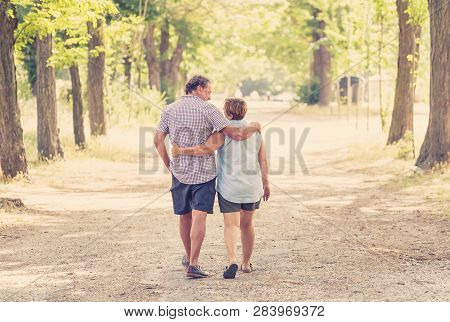 Happy Senior Couple Walking And Enjoying Life Outdoors