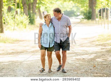 Happy Senior Couple Walking And Enjoying Life Outdoors