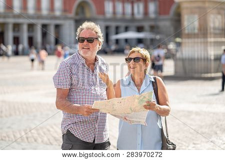 Senior Couple Lost Using City Map For Finding Their Location In Europe