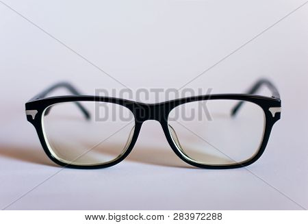 Anti Blue Light Computer Glasses On The White Background. Glasses To Protect Your Computer Vision.