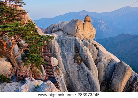 View of stones and rock formations from Ulsanbawi rock peak on sunset with staircase. Seoraksan National Park, South Corea