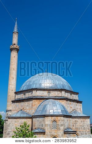 Beautiful Ottoman Architecture Of The Sinan Pasha Mosque With A Blue Sky In Prizren, Kosovo