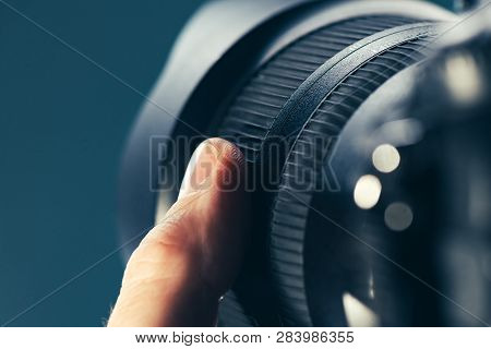 Photographer Using Zoom Lens On Dslr Camera, Close Up Of Finger Rotating The Ring On Photographic Eq
