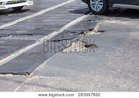 Very Bad Quality Road With Potholes. Hole In Asphalt, Bad Asphalt. Pit, Unsafe, Hole Road. Transport