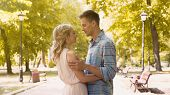 Loving couple gently embracing, enjoying long-awaited date in park, first love, stock footage poster