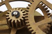 Gears from an antique clock in a close up view. poster