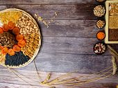 nuts seeds dried apricot raisin, cereal food high in antioxidants, anthocyanins, smart carbs and vitamins. poster