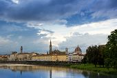 The Arno river and the cloudy Florence. View of the Cathedral of Santa Maria del Fiore, the Basilica of Santa Croce, Palazzo Vecchio and the Arno River on a rainy day. Florence, Italy. poster