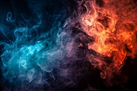 Abstract Art Colored Smoke Red And Blue On Black Isolated Background. Stop The Movement Of Multicolo
