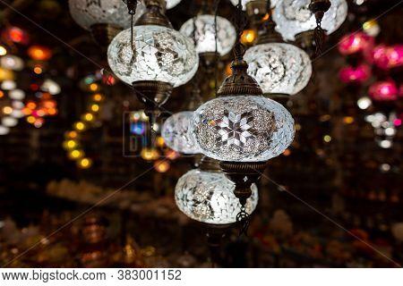 White Glass Lamps Hangs In A Souvenir Shop