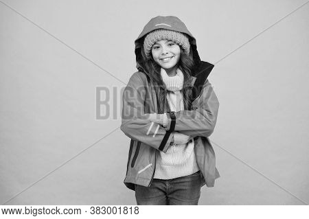 Winter Vacation. Protective Clothes. Happy Smiling Kid. Properly Equipped. Ski Resort Concept. Winte