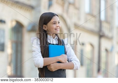 Open Lesson. Little Child Hold Lesson Book Outdoors. Back To School. Private Lesson. Class And Tutor
