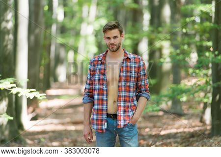 Sexy Macho In Unbuttoned Shirt. Young Unshaven Man Has Bare Torso Outdoor. Male Beauty And Fashion.