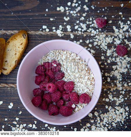 Oatmeal Porridge With Raspberries And Toasts On Black Background. Healthy Lifestyle. Ecofriendly. Oa