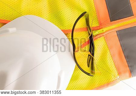 Safety Vest, Safety Glasses And Safety Helmet Or Hard Hat Studio Closeup