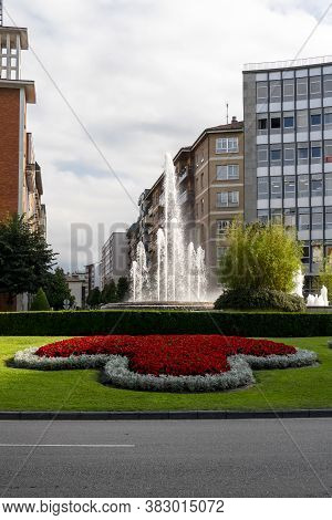 Oviedo, Spain, Asturias - August 2020: Square With A Fountain And Beautiful Flowers And Vegetation A