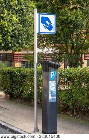 Oviedo, Spain, Asturias - August 2020: Parking Payment Machine With A Blue Sign Symbolizing A Hand H