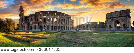 Panorama of the Colosseum and Arch of Constantine the Great at sunrise, Rome. Italy