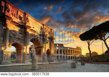 Arch of Constantine the Great and the Colosseum at sunrise, Rome